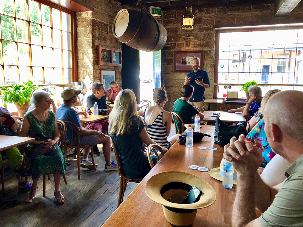 Introducing the history of the Lord Nelson Hotel and Brewery before a walking tour